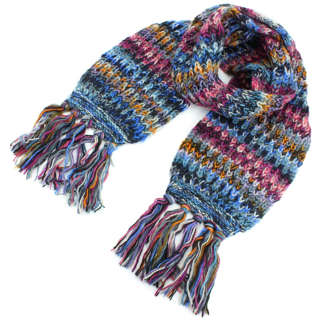 Product Features plaid scarf perfect for a cooler day. Crafted from % wool for a.
