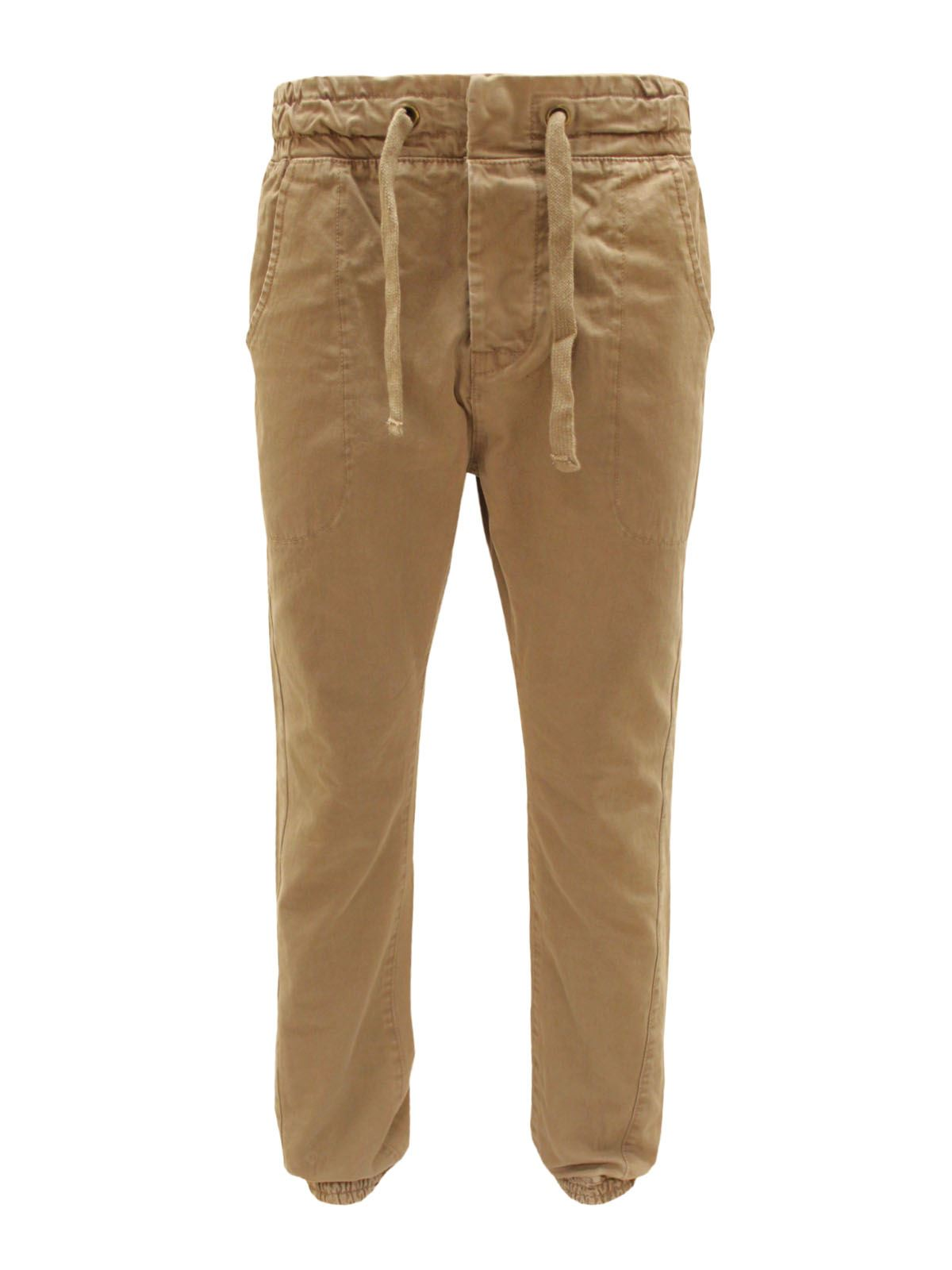 """There are three basic ways for a man's trousers to """"break,"""" or rest at the bottom: Too high and your dress pants turn into ankle-hugging Trousers with a cuff on ."""