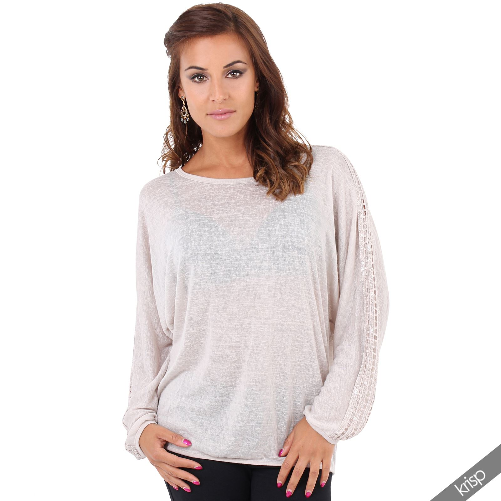 The Women's Embellished Tunic Sweater instantly creates a stylish, laid-back look. The A-line sweater features various types of knit detailing for a one-of-a-kind feel. It has a scalloped hem, an interesting detail on the back and a contrasting knit deta.