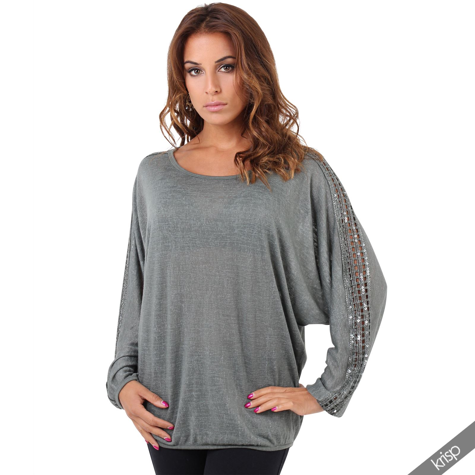 Slightly fitted through body. Tunic sweater hits at hip. Model is approximately 5'9
