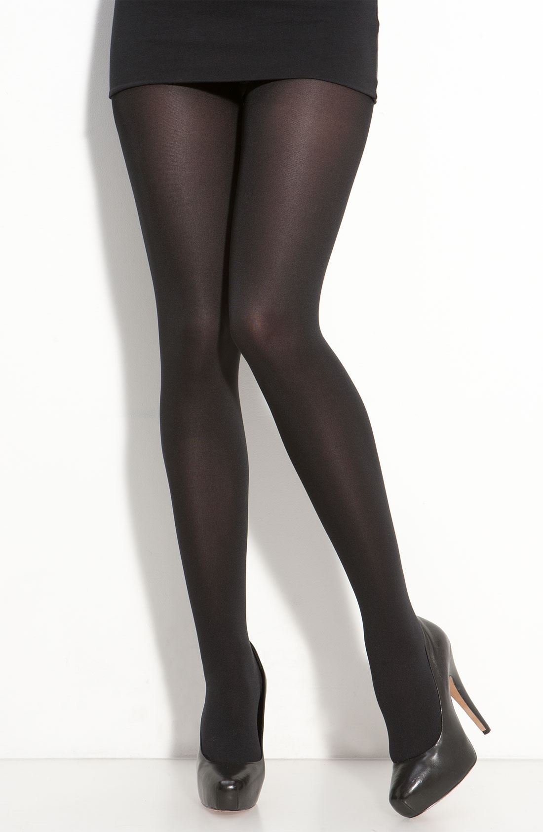 The LBD of hosiery. As the temperature dips, reach for our opaque black tights to keep your dresses and skirts in heavy rotation. Plus, we designed them with a control-top waistband to keep your profile sleek. Control-top opaque tights Nylon/spandex. Hand wash cold. Imported.